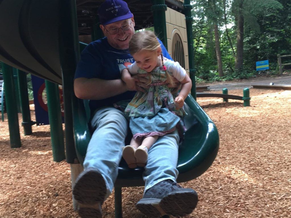 Grandpa Dale helps Olivia celebrate her third birthday